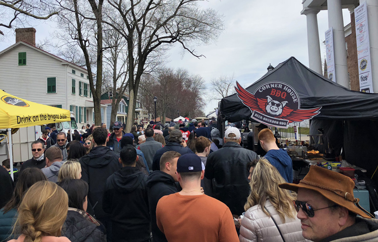 Crowds wait patiently to try Corner House BBQ, a new Staten Island BBQ joint opening April 20, at the 2018 NYC BBQ Cookoff. Corner House later won the people's choice award for its pulled pork.