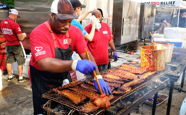 Curtis Barnes, lead coordinator for Operation BBQ Relief in NYC, works at the Big Apple Barbecue in June 2018 to raise awareness and money for the organization.