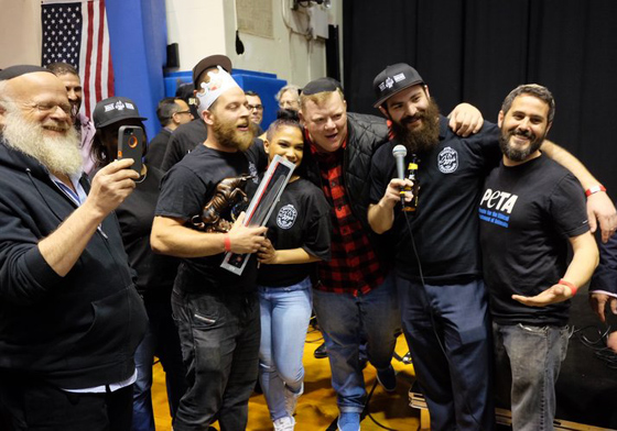 Three winners of Brisket King — Sruli Eidelman, Billy Durney, and Ari White — pose at the 2017 Brisket King where Eidelman won the crown