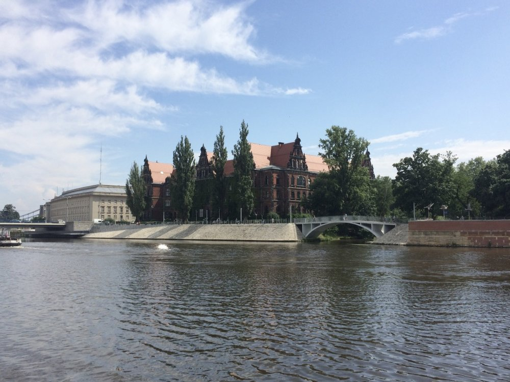 Wroclaw, Poland - view of the National Museum (right) and the Government Center (left) from the Oder river