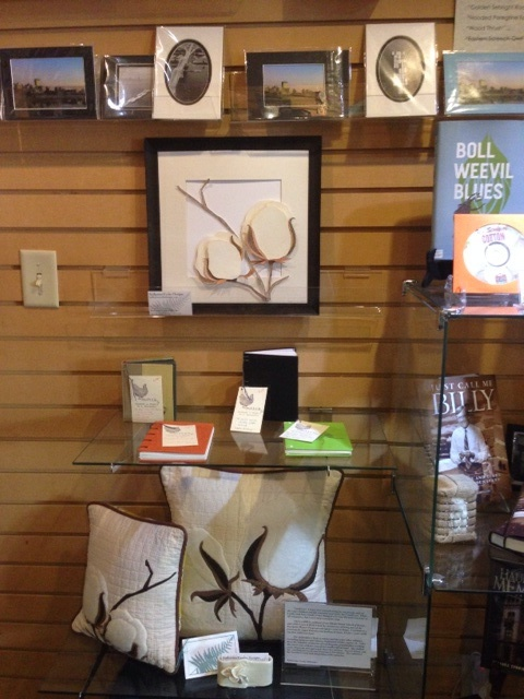 Several pillows and a hand colored illustration are currently for sale in the gift shop.