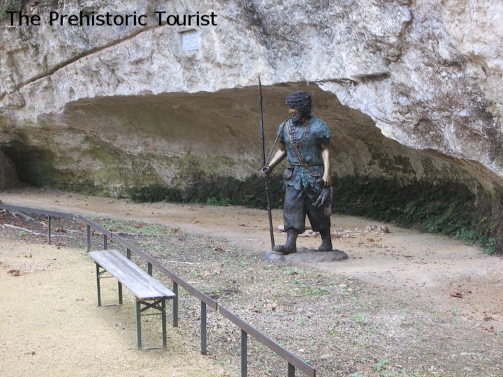 The site of the discovery of the bones is marked with a plaque and a statue of a Cro-Magnon man