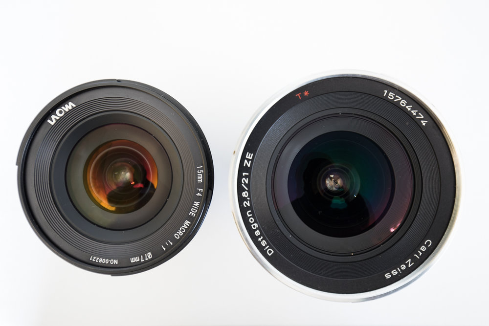 The Laowa 15mm consistently has an orange tinge to the front lens elements, unlike the Zeiss 21mm which is clearer and a little green or purple.