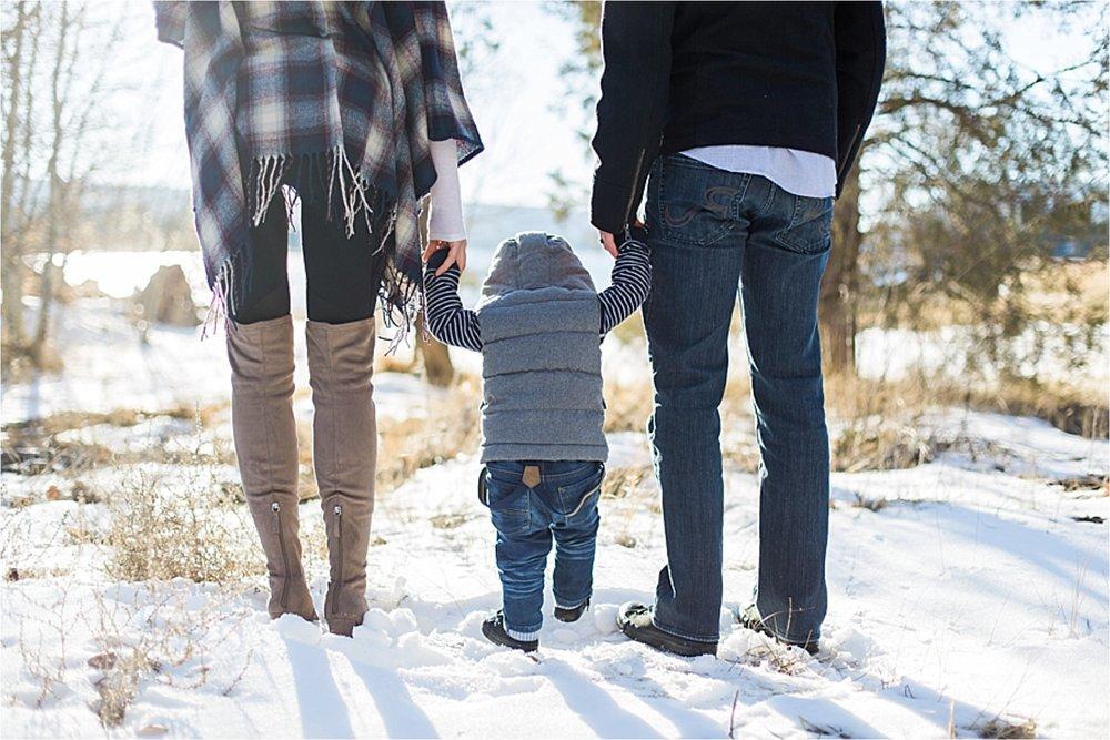 Family walk along the lake