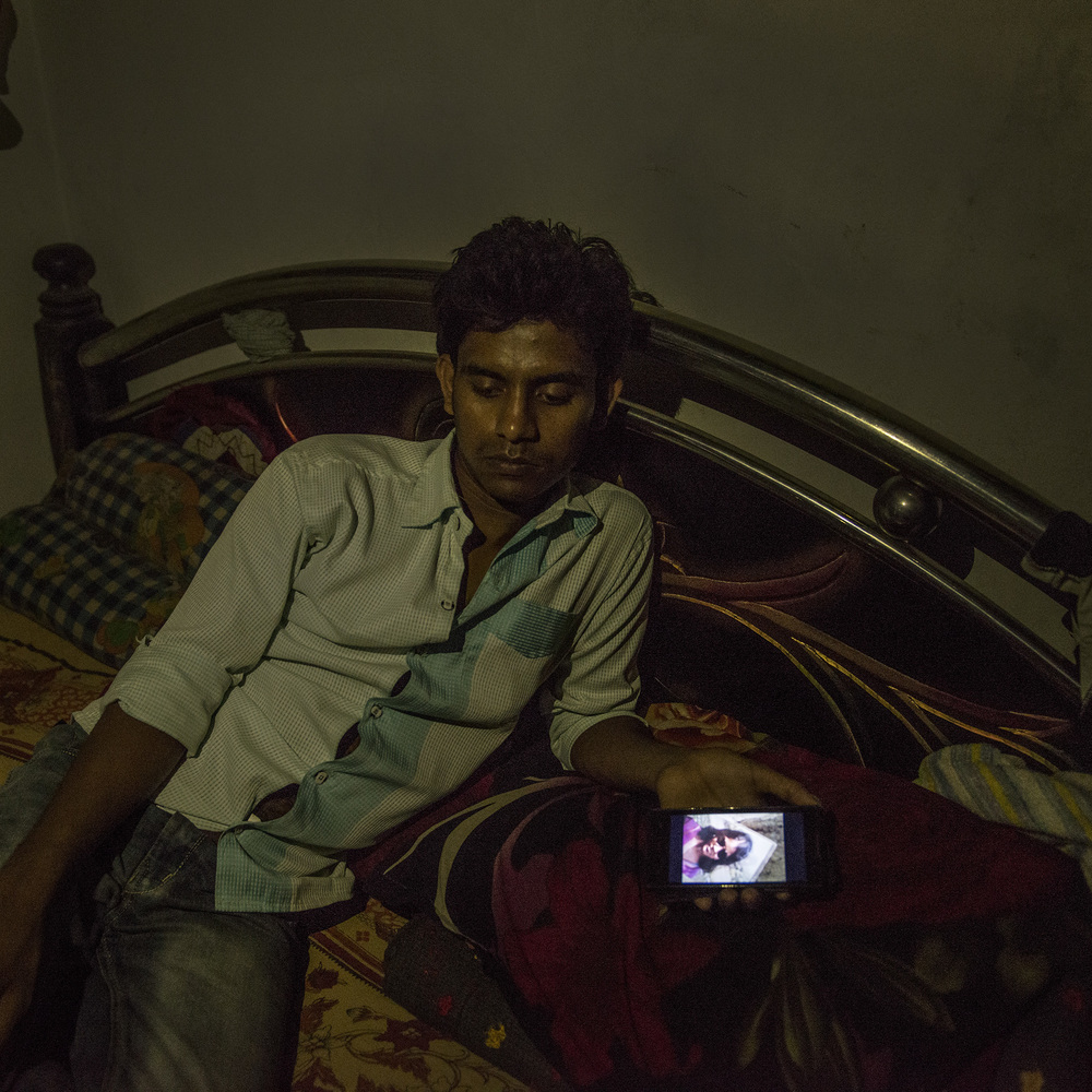 All day, Raihan Kabir looks longingly at the photo of his beloved Rupa, who died during the Rana Plaza collapse. He can never see her again, but in photos.