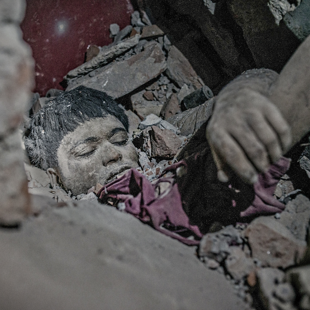 A dead body stuck in rubble of rana plaza