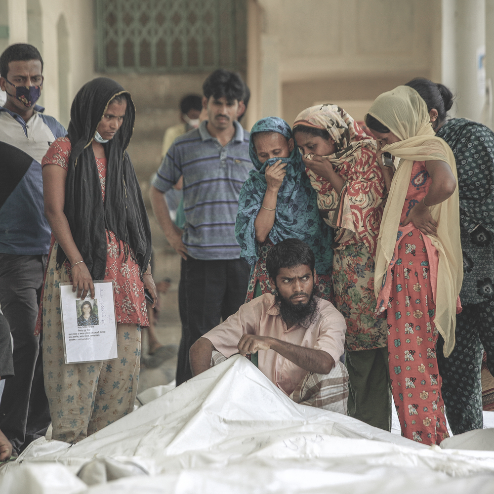 Dead body of a Rana Plaza incident victim in front of relatives  of lost people