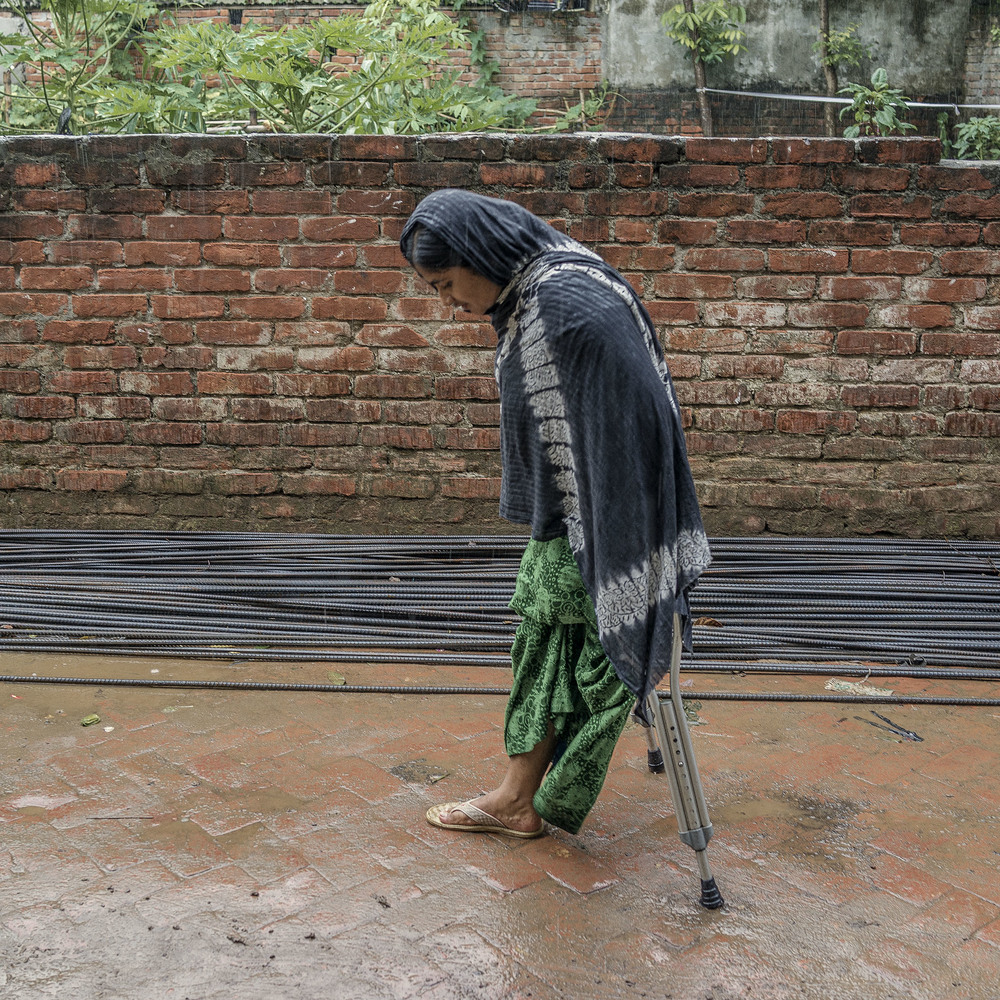 Suffering from losing one leg during the collapse, Mosammat Rehana Akhtar, limps through life searching for a better tomorrow