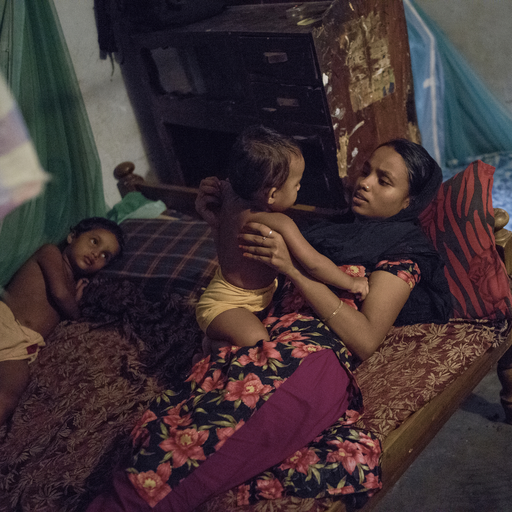 Rabeya Khanam, Rana Plaza survivor, plays with younger siblings