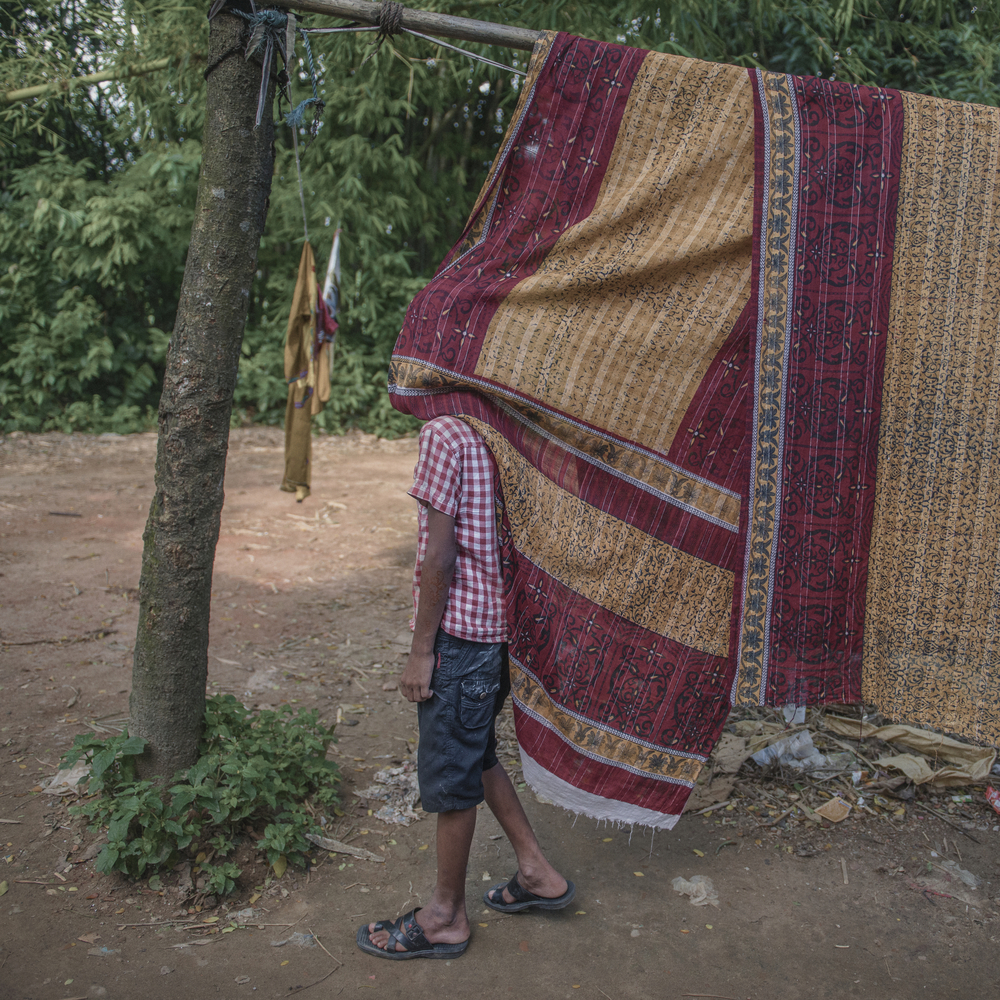 Shagor, Jahanara Begum's son, walks around listlessly as he reflects on his mother's sudden death in the Rana Plaza collapse