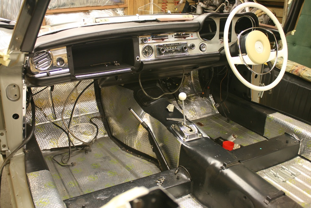 dash re assembly begins, including restored ivory steering wheel