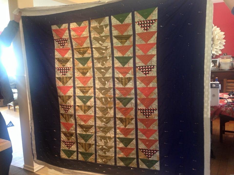 My first proper quilt. I used the Flying Geese pattern.