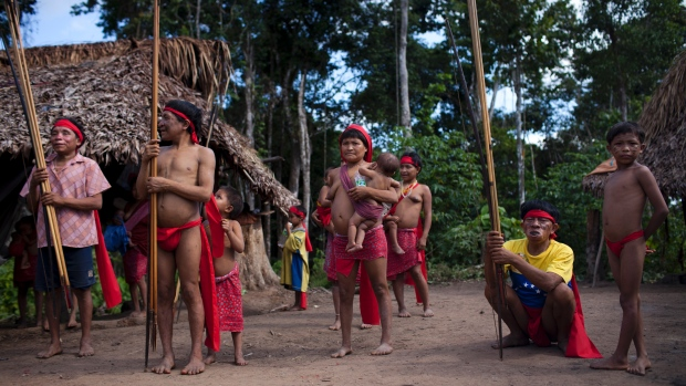 From the CBC: The Yanomami of the Venezuelan Amazon.  People aren't totally sure where the t-shirts came from.