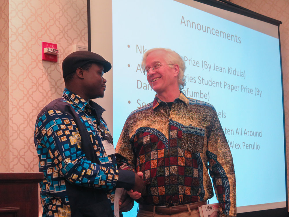 Mhoze Chikowero and Banning Eyre share the prize. Nice shirts, guys!