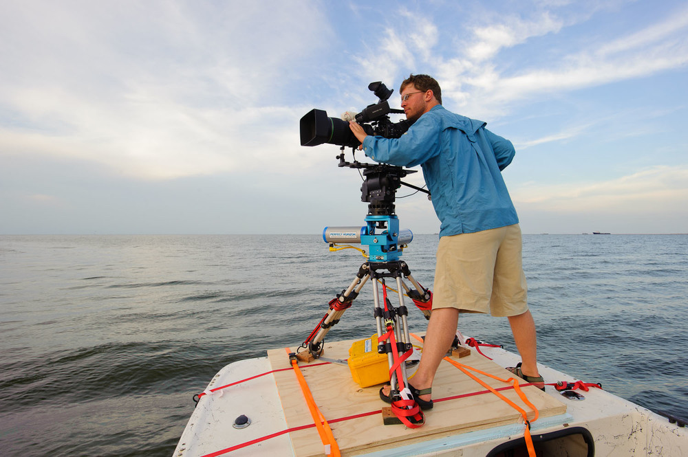 Benjamin Clock filming with Sony PMW-350 and Perfect Horizon stabilizer in Barataria Bay, Louisiana during the Gulf oil spill. Photo by Gerrit Vyn.
