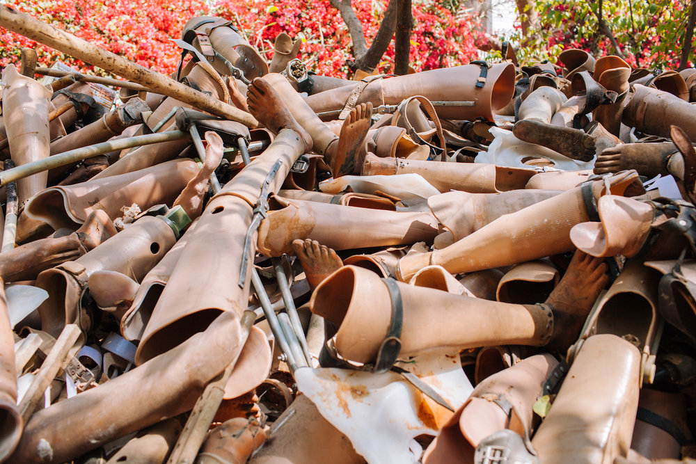 Discarded prosthetic limbs fill the courtyard of Bhagwan Mahaveer Viklang Sahayata Samiti (BMVSS), also known as Jaipur Foot. BMVSS is an organization based in Jaipur, India, specializing in low-cost artificial limbs.