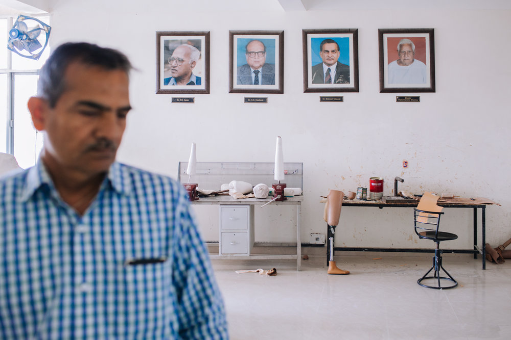 An intense collaboration between a sculptor Ramchandra Sharma, Dr. Sethi, Dr. Kasliwal and Dr. Udawat (their portraits hanging on the wall of BMVSS's research facility) ignited the beginning of Jaipur Foot's story. Their mission was to design a low-cost prosthesis that could be manufactured and fitted quickly, using a simple process and local materials.