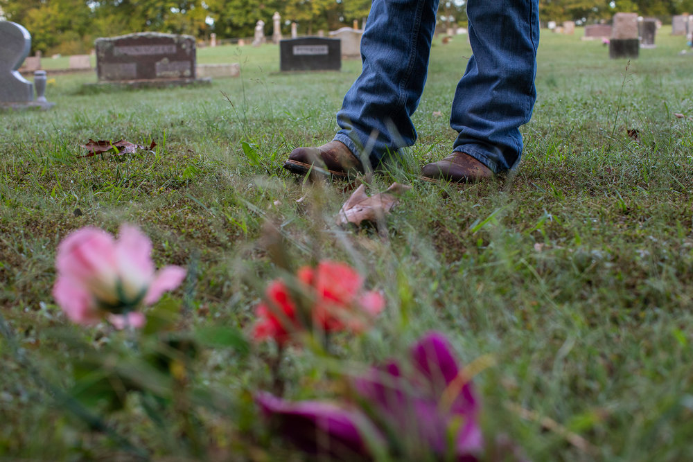 Brenda visits her sister's grave.