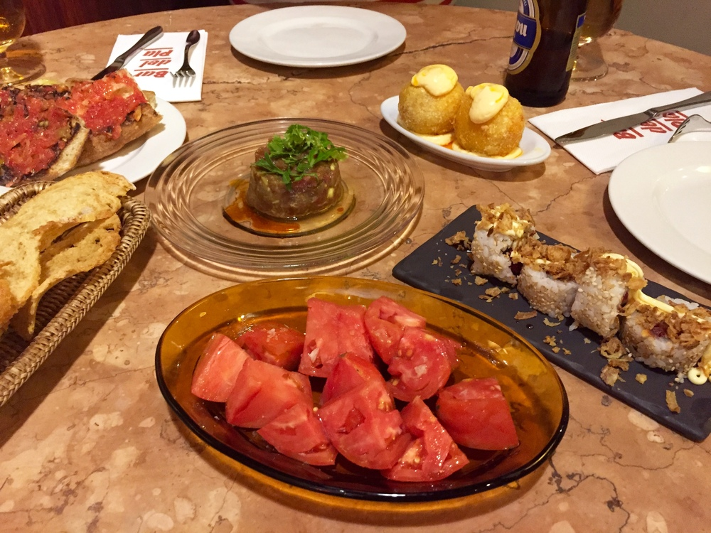 A mix of tapas at Bar del Pla; Tomatoes from Tudela, Tuna Tartare, Uramaki and Octopus Bombas