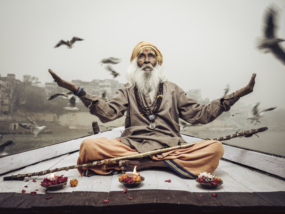 Sadhu on a boat on the Ganges with the ancient city of Varanasi as a backdrop. Shot with the Fujifilm GFX and the 32-64 lens. Lit with an SMDV BRiHT 360 flash and a gridded SMDV 85 Speedbox. No pigeons were harmed in producing this photo.