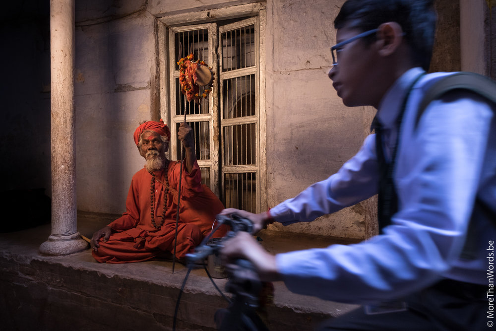 Old meets young in the narrow alleyways of Varanasi