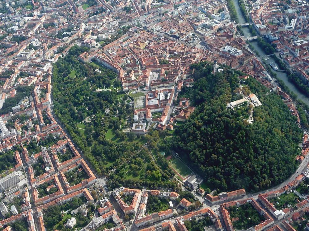 Graz from the air. Green areas of Schlossberg, the Stadt Park and the private inner courtyards.