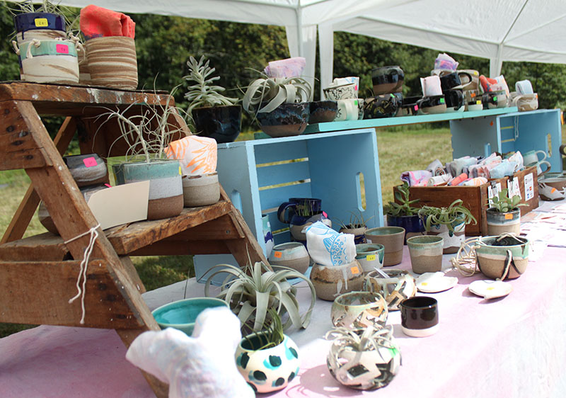 Christina Kosinski came down from Boston to sell her colorful handmade pottery and textiles.