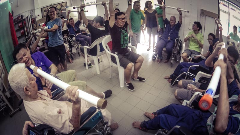"Our volunteers spurring the senior uncles by shouting ""Huat ah!"""