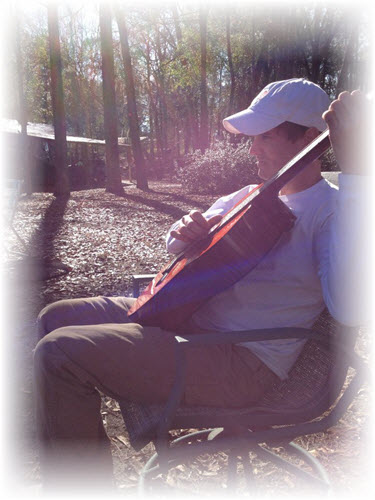 Strumming a slow tune near the river.