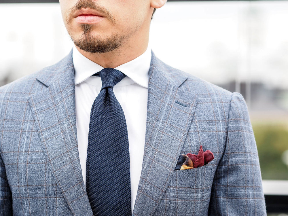 the right tie and pocket scarf make all the difference