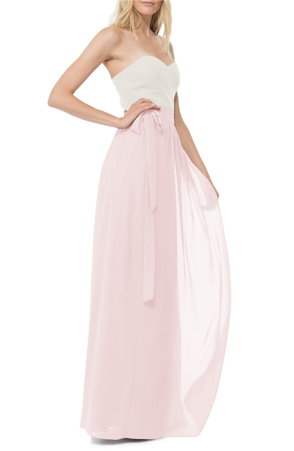 Designed for universal flattery, a sweeping chiffon skirt boats classic wrap styling with a defined waist by Joanna August.