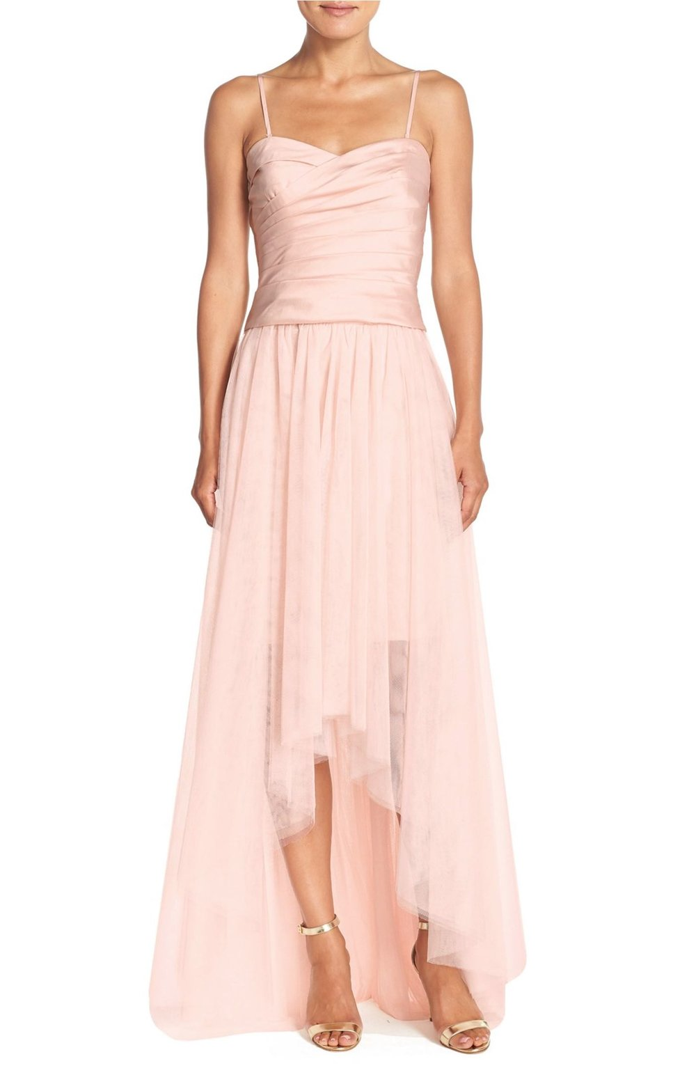 Reminiscent of a prima ballerina this high low tulle skirt by Monique Lhuillier brings a fresh look to a formal affair.