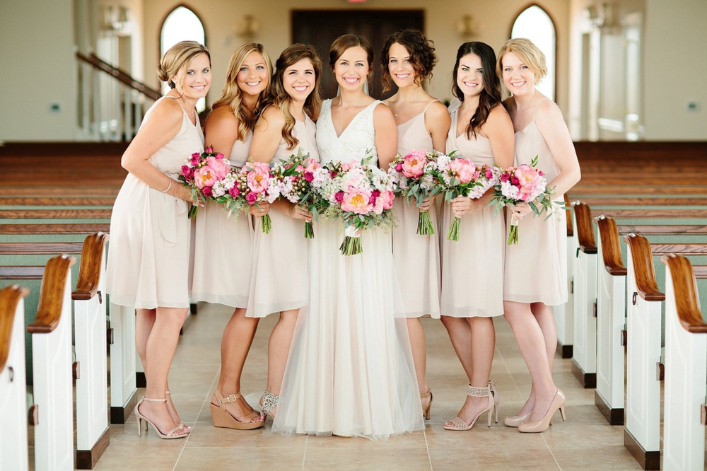 Dessy-Beige-bridesmaids-dresses-with-pink-bouquets-Tucker-Images.png