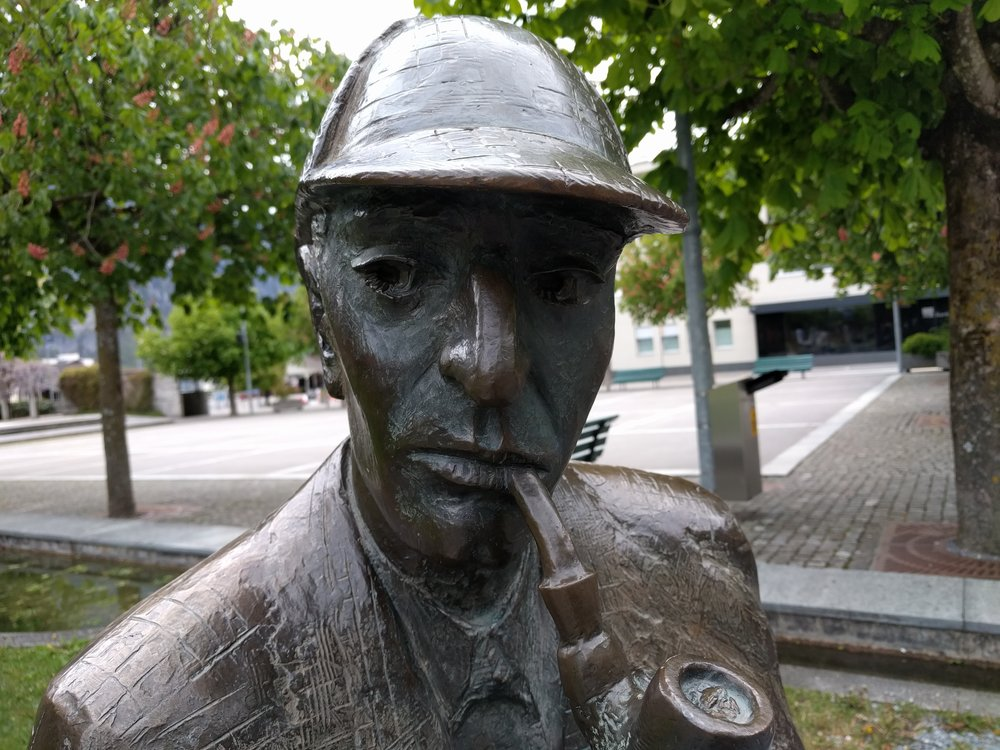 I find his eyes really disturbing, in that he has no eyes. They look scratched out, maybe by an angry Moriarty or a fed-up Mrs. Hudson. Doubleday supposedly put clues to all of the Sherlock Holmes stories into this sculpture. I forgot to check. I was so weirded out by his eyes.