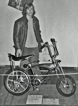 1975 Showing his bike at motorcycle show.jpg