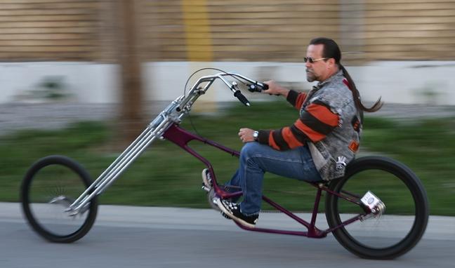 John Brain Brain   rides purple bike.JPG