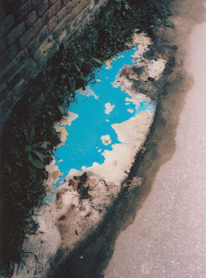 Blue puddle 2009 Kathmandu Nepal from the series As Dust Alights.jpg