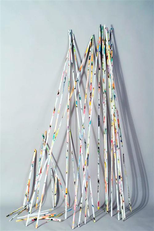 "25 sticks   Acrylic, ink on wood / 84"" x 1/2"" x 1/2"" / 2007"