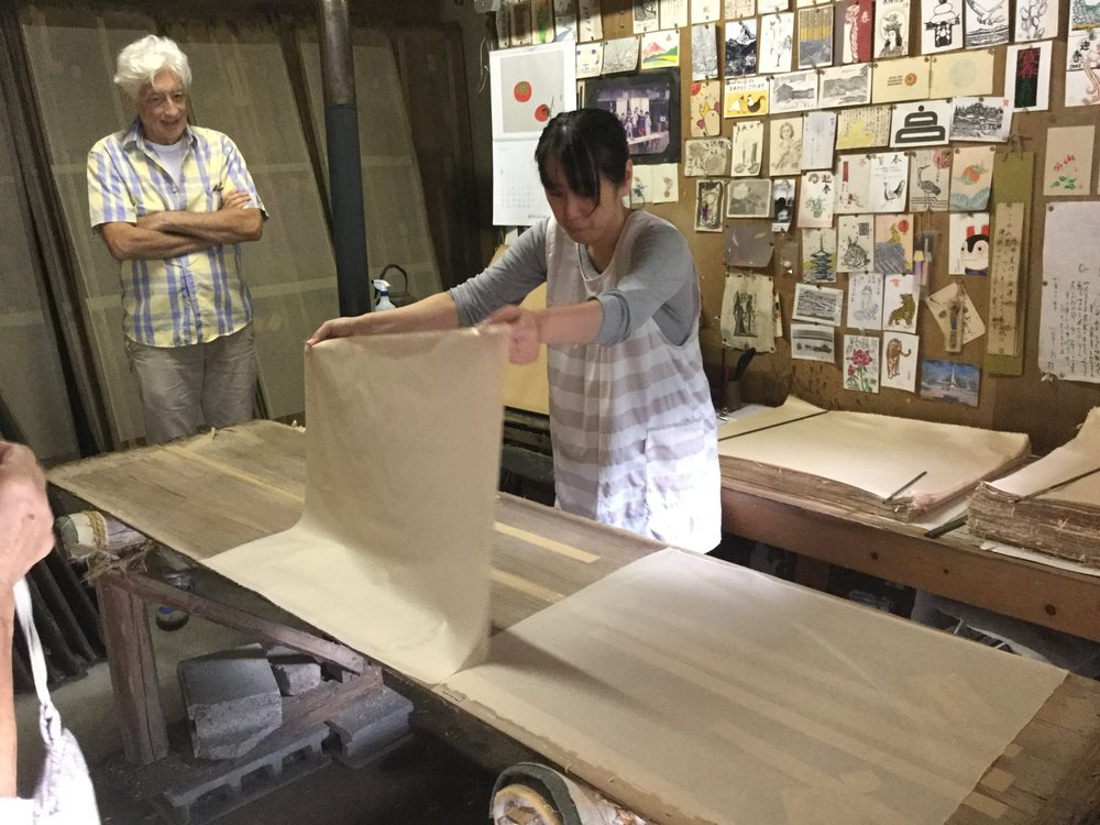Here the papermaker is removing dry sheets from the drying boards. She will now add this sheet to the pile behind her which has finished products ready for shipping. This load is going to Ishikawa Prefecture.