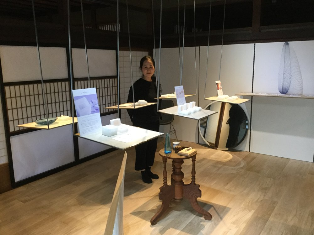 Yuka behind the jewelry display
