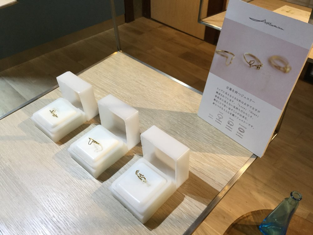 And here is a set of rings called Love Hope and Freedom. The ring boxes are made out of candle wax - there is a wick at the bottom! The plan is that you get a ring, turn the box into light by burning it and never take the ring off.