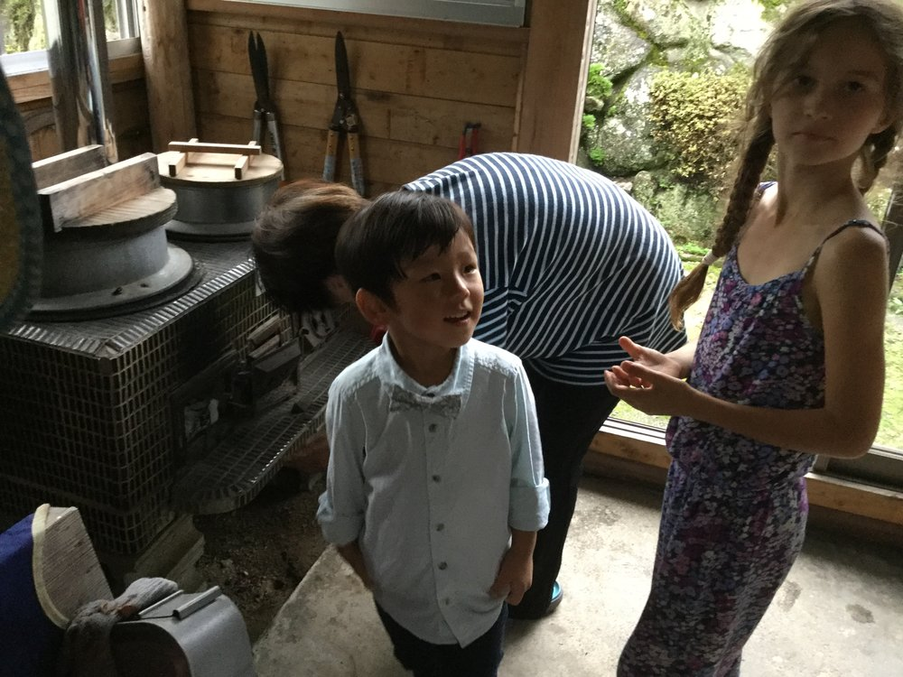 Aito and Lili got to help with starting the wood stove. Aito is already wearing his party clothes - note the groovy bow tie.