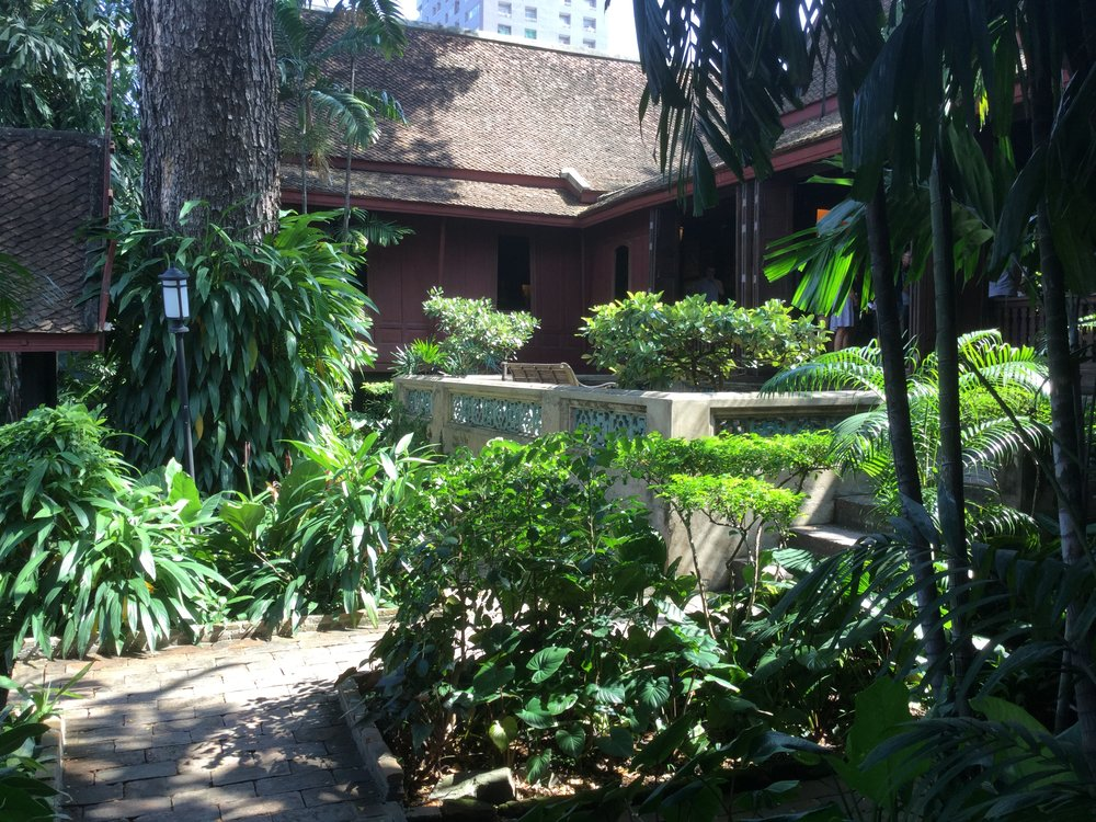 The house is gorgeous - a tropical compound of small buildings grouped around a verdant courtyard by the Chao Phraya river.