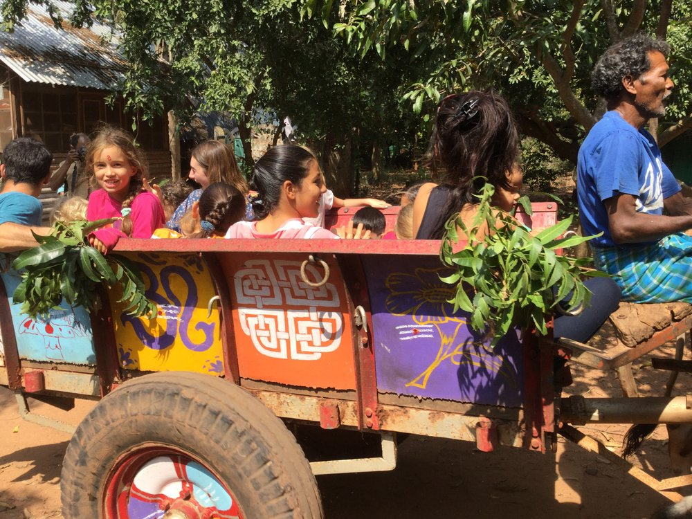 ...and they are off! During the ride, the tradition is that the riders get sprinkled with cow urine! This was done, but to Lili's relief we told her that it was only water dyed with turmeric.