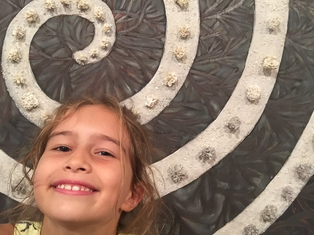 This is from another floor. Lili wanted to take a selfie of this piece close by to see all the bits glued onto it. This exhibit was by Sandra Felzen and it was inspired by the Brazilian coastal ecosystems.