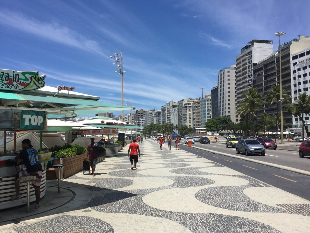 This type of sidewalk mosaic is a Rio specialty. The stone is called 'Portuguese stone' .
