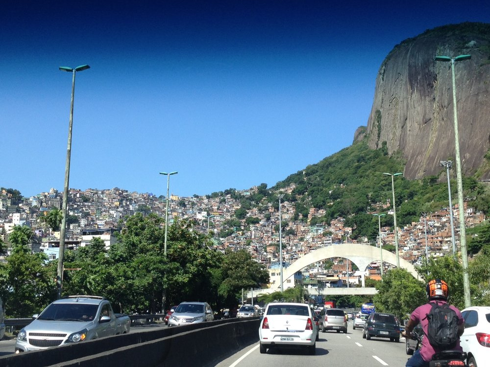 Rocinha favela, between Barra de Tijuca and Ipanema. You can see how the structure of the city changes as soon as the buildings start climbing the slope - that is the favela. Dante asked for public photo credit for these two pics that he expertly took from the car window:  Photos Dante Comoglio
