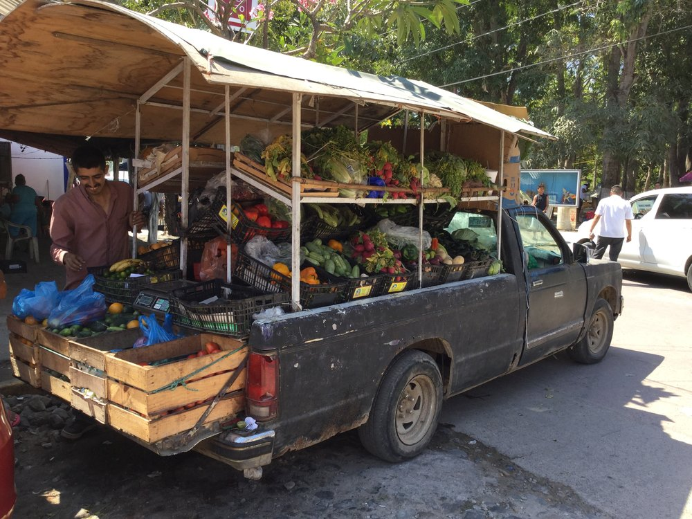 In Mexico, you can buy many things from the back of a car. Here are a couple of examples - first pastries in Sayulita, and then a fellow who basically operates an entire farmers market from the back of a pick up truck in San Pancho.