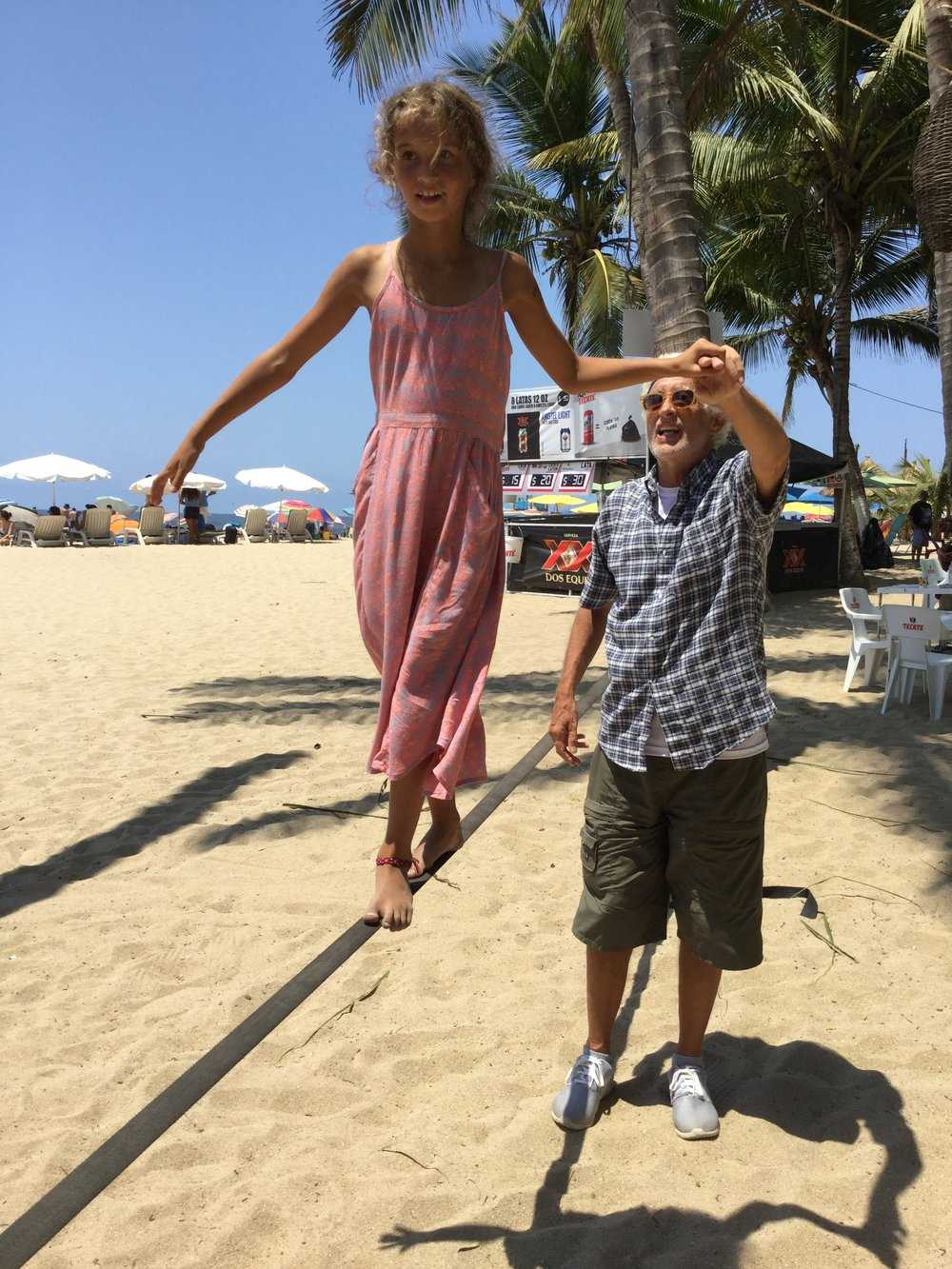 Practicing slacklining in the San Pancho beach. It is not as easy as it looks...