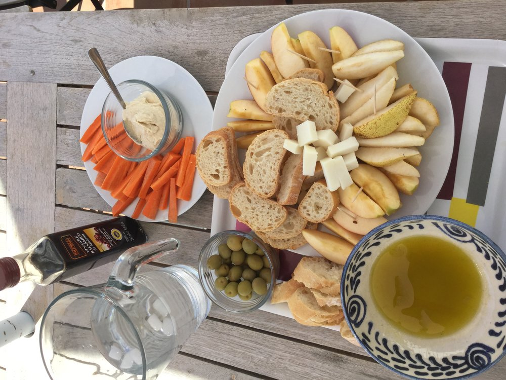 Our meal after the fair. Olives, dunking bread in olive oil and balsamico. Veggies and hummus. Local cheese and fruit.